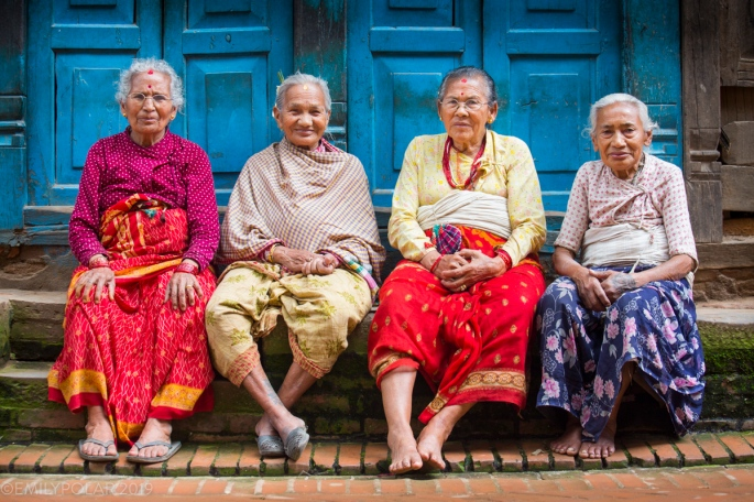 Nepali women sitting on the curb in the quaint streets of Bhaktapur. Women at this age are sweetly called Aaji meaning old aunt or grandma.