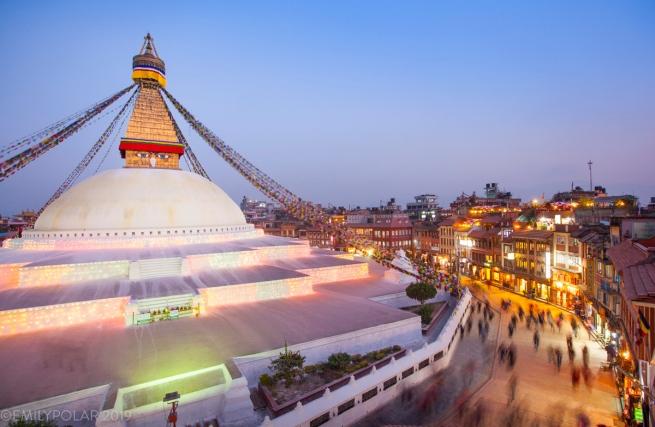 The Boudha Stupa in Kathmandu is a sacred Buddhist site. Pilgrims circumambulate clockwise around the stupa spinning prayer wheels, reciting mantra and making aspirations/prayers.