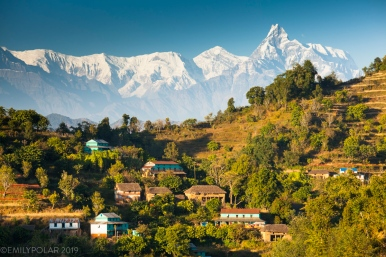 The small village of Khilung rests on terraced hillsides below the Annapurna range in the Himalaya of Nepal. A village only accessible by 4x4 vehicles, by foot or for the more adventurous, paragliding.