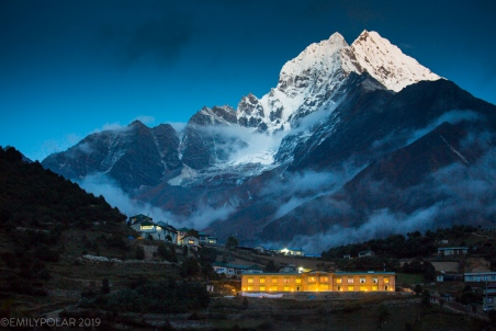 Yeti Mountain home Hotel lights up at dusk below Thamserku mountain in Namche Bazaar. The last village of such luxury accomodation in the Khumbu region of Nepal.