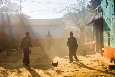People and chickens of the village of Sirkot out for a walk in the smoke that is a result from the trash burn that day. Majority of villages have no waste disposal system other than burning.