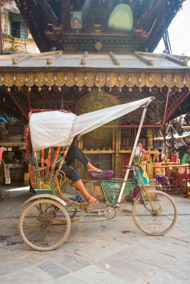 Rickshaw driver taking a rest in the streets of Kathmandu, Nepal.